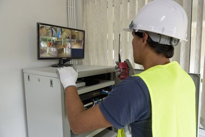 Security Camera Technician Checking Installation